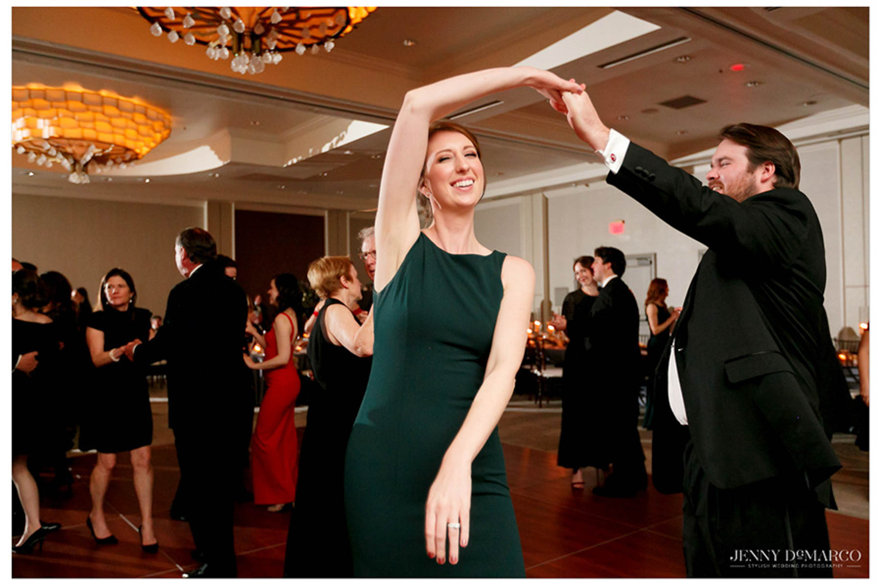 couple twirls during the dance and laugh