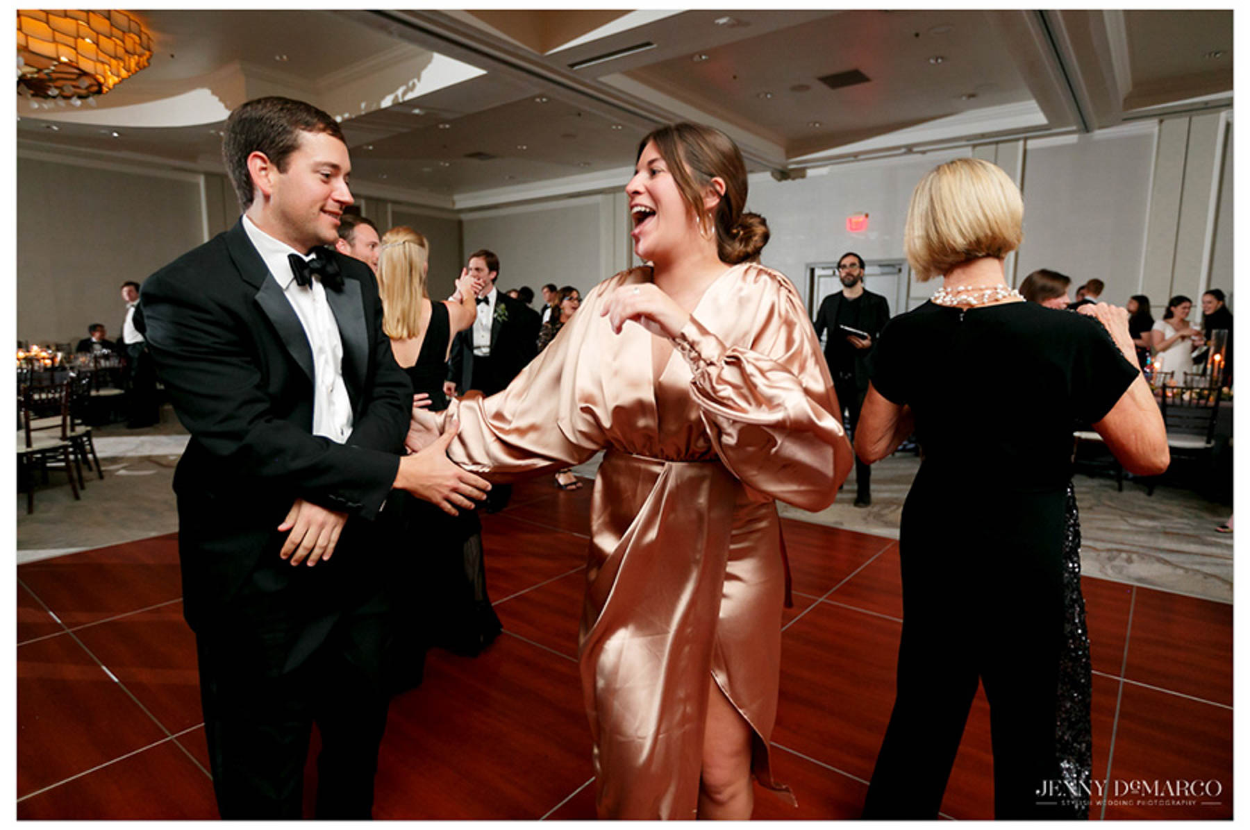 man and woman dance on the dance floor at the reception