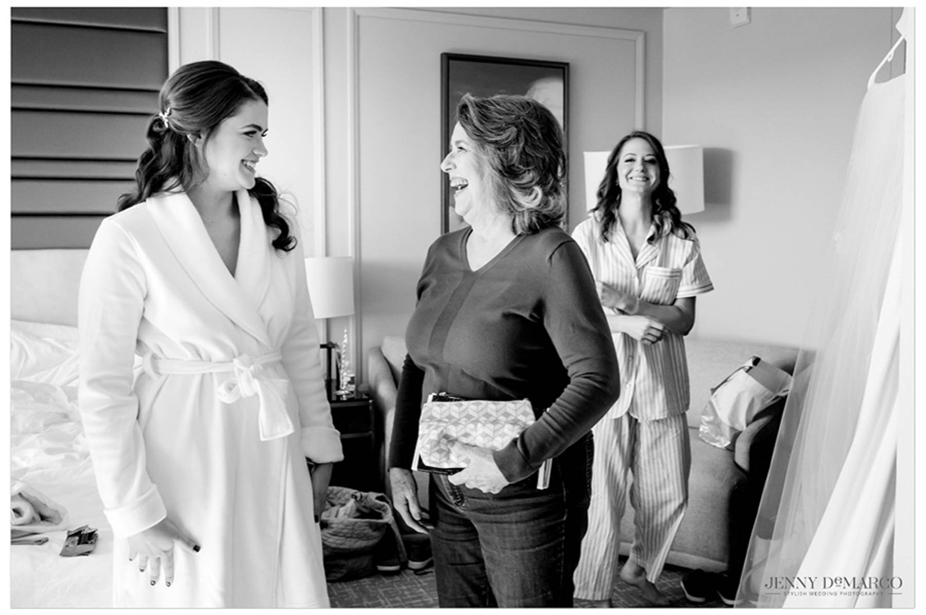 bride smiles before she puts on her dress