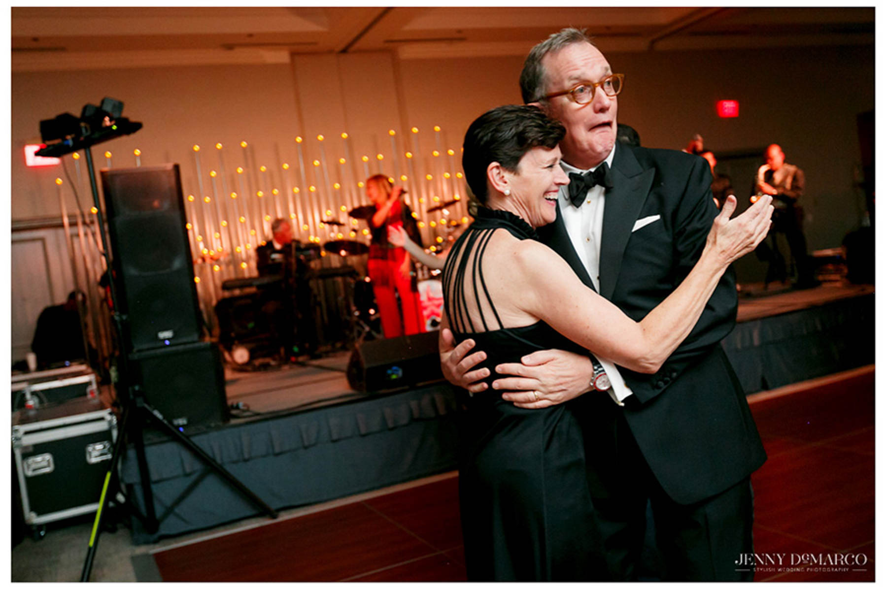 man and woman make faces while they dance at the reception
