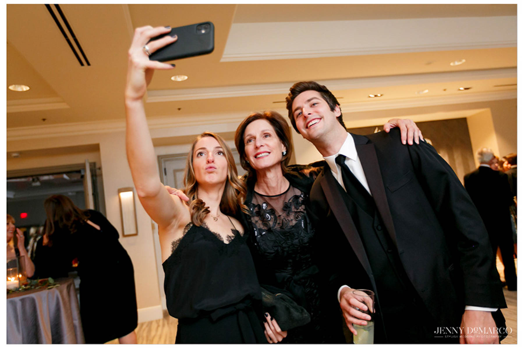 family members take a selfie on an iPhone during the reception