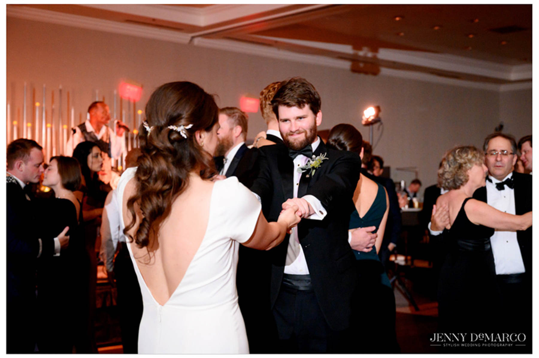 bride dances with brother on the dance floor at the reception