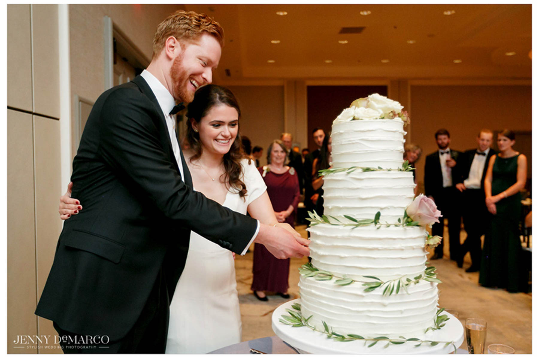 bride and groom take a cut into the cake