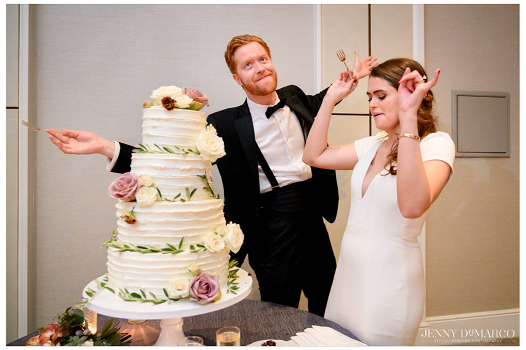 bride and groom celebrate the first bite of their wedding cake and dance in excitement