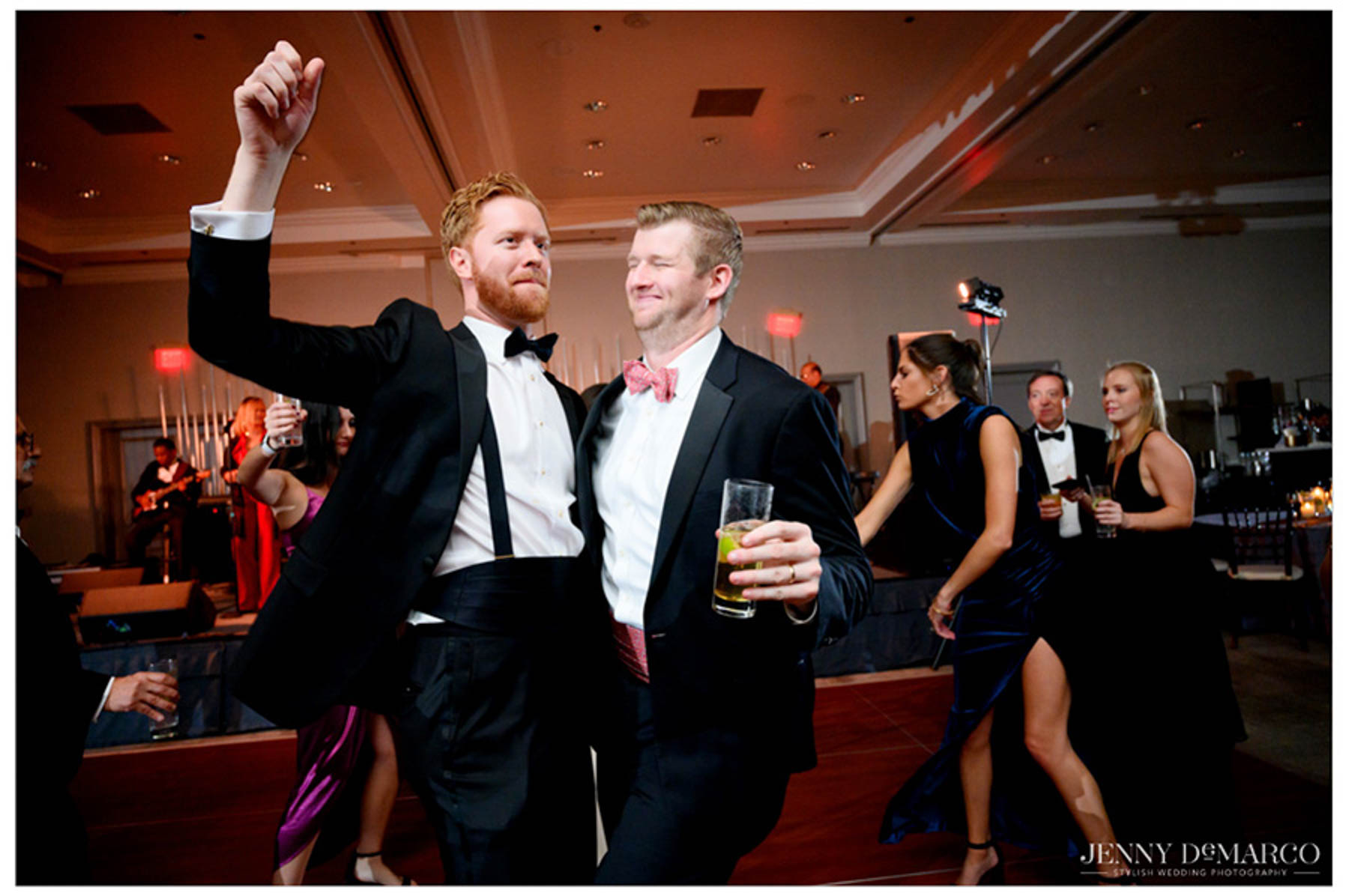 groom dances with friend during the reception