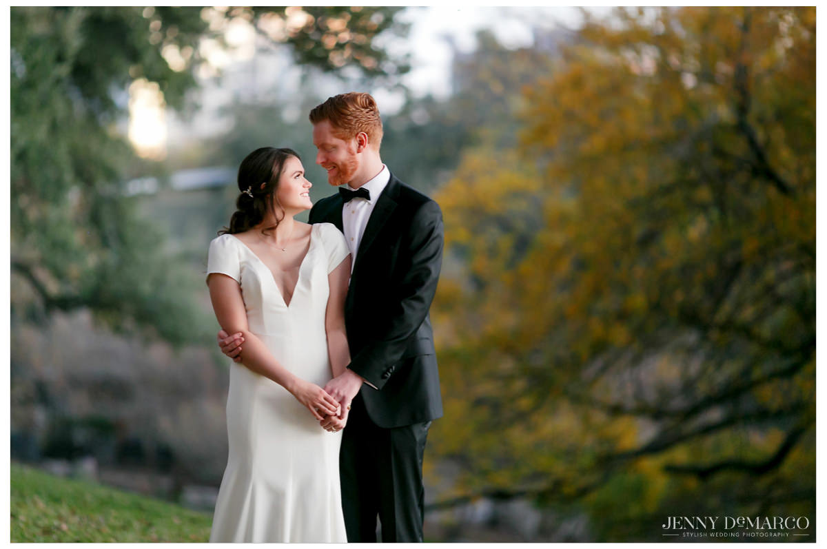 bride and groom hold each other surrounded by trees and nature