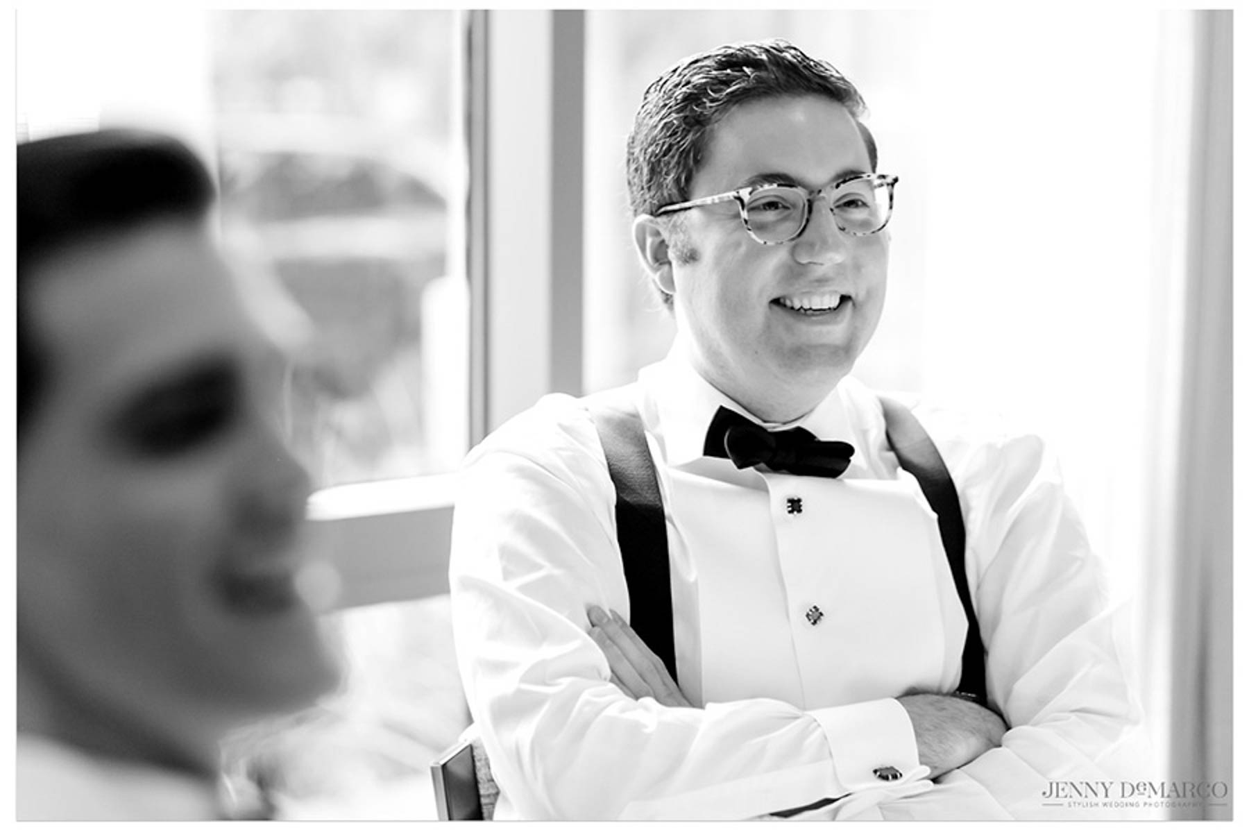 friend of groom smiles and laughs with his friends