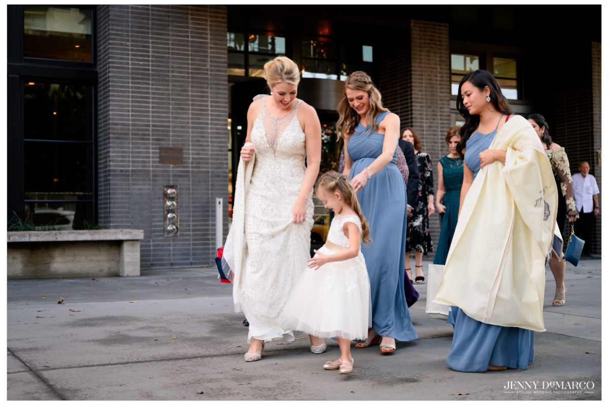 Bridesmaids and Bride walking to the church for the wedding.