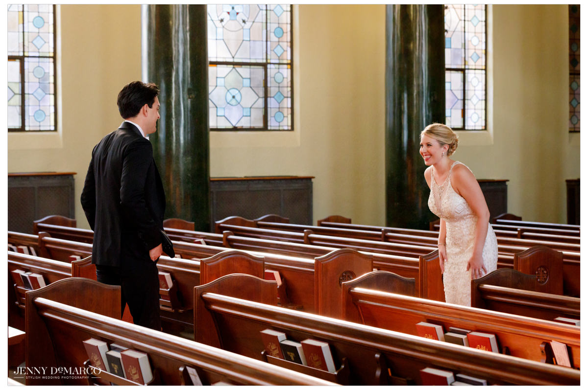 Groom and bride seeing each other for the first time on their wedding day