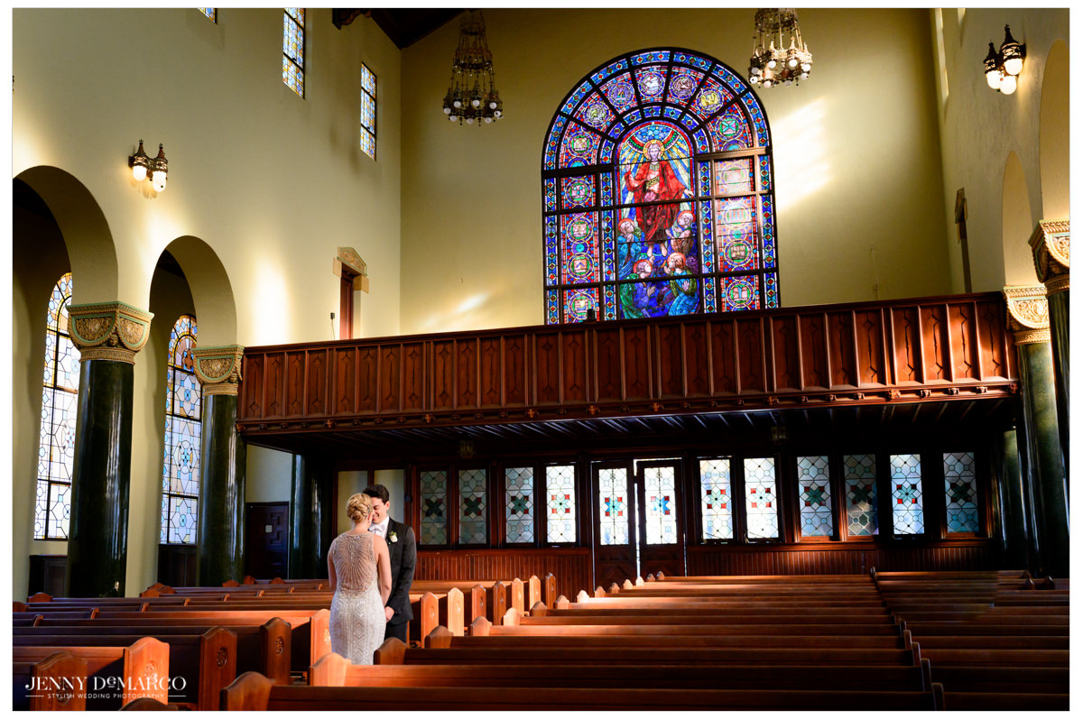 Bride and groom sharing an intimate moment in central christian church