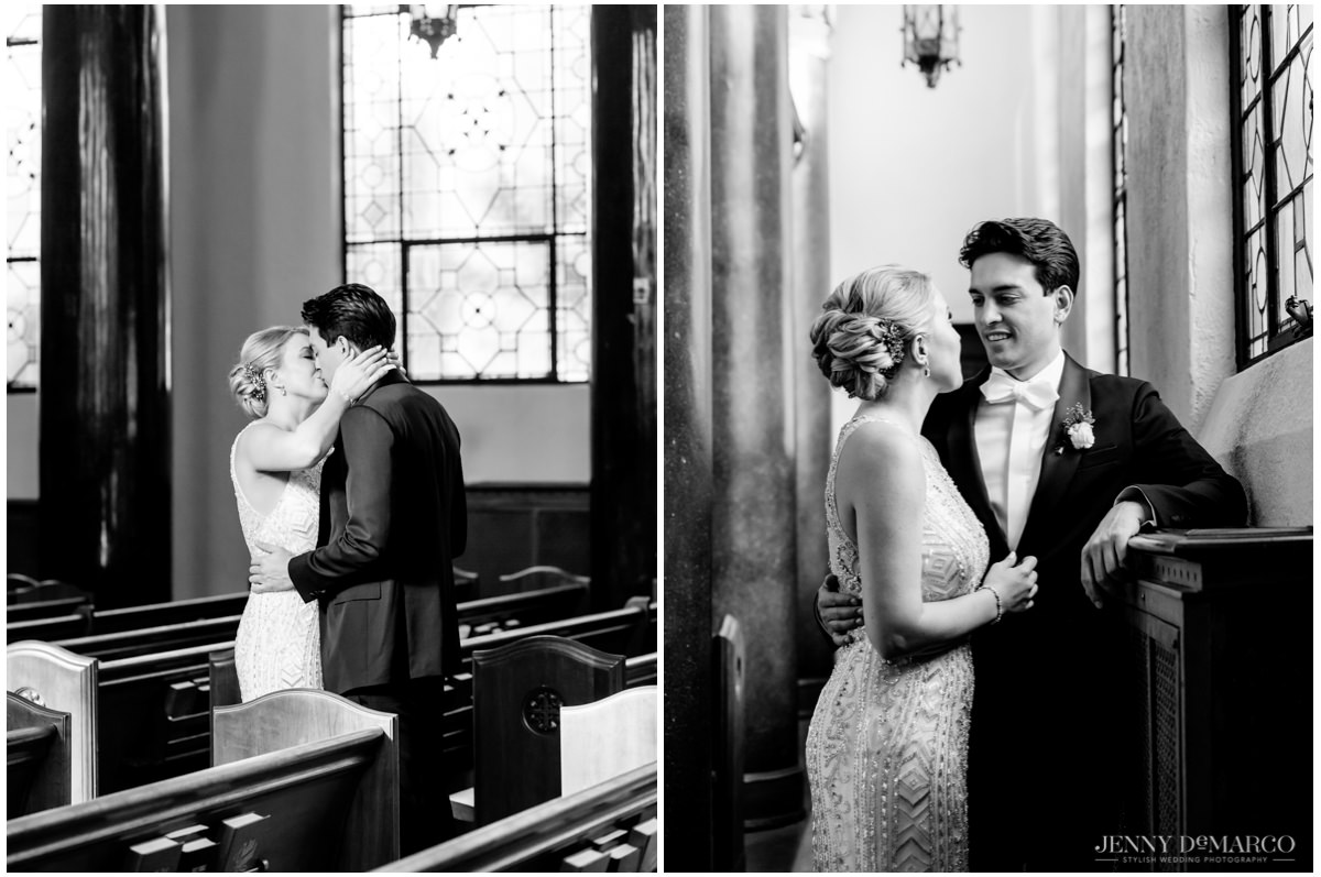Bride and groom kissing and lovingly looking at each other in central christian church