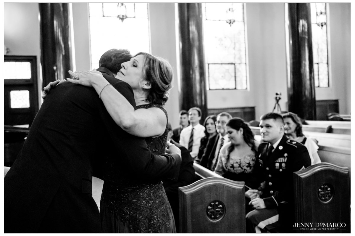 groom hugging his mother before the wedding ceremony