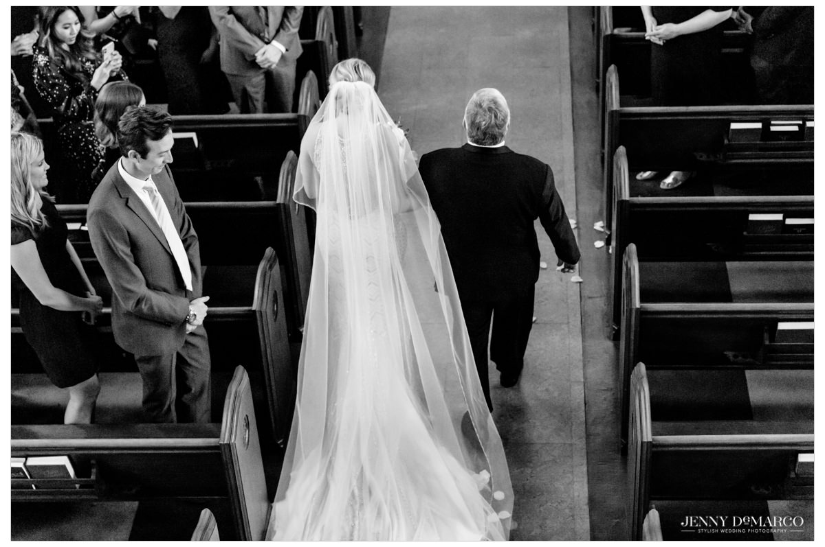 father of the bride walking his daughter down the aisle