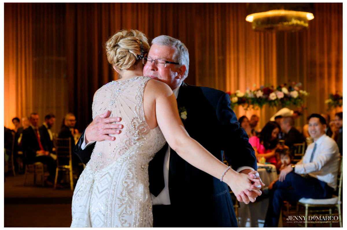 bride dancing with her father at the reception