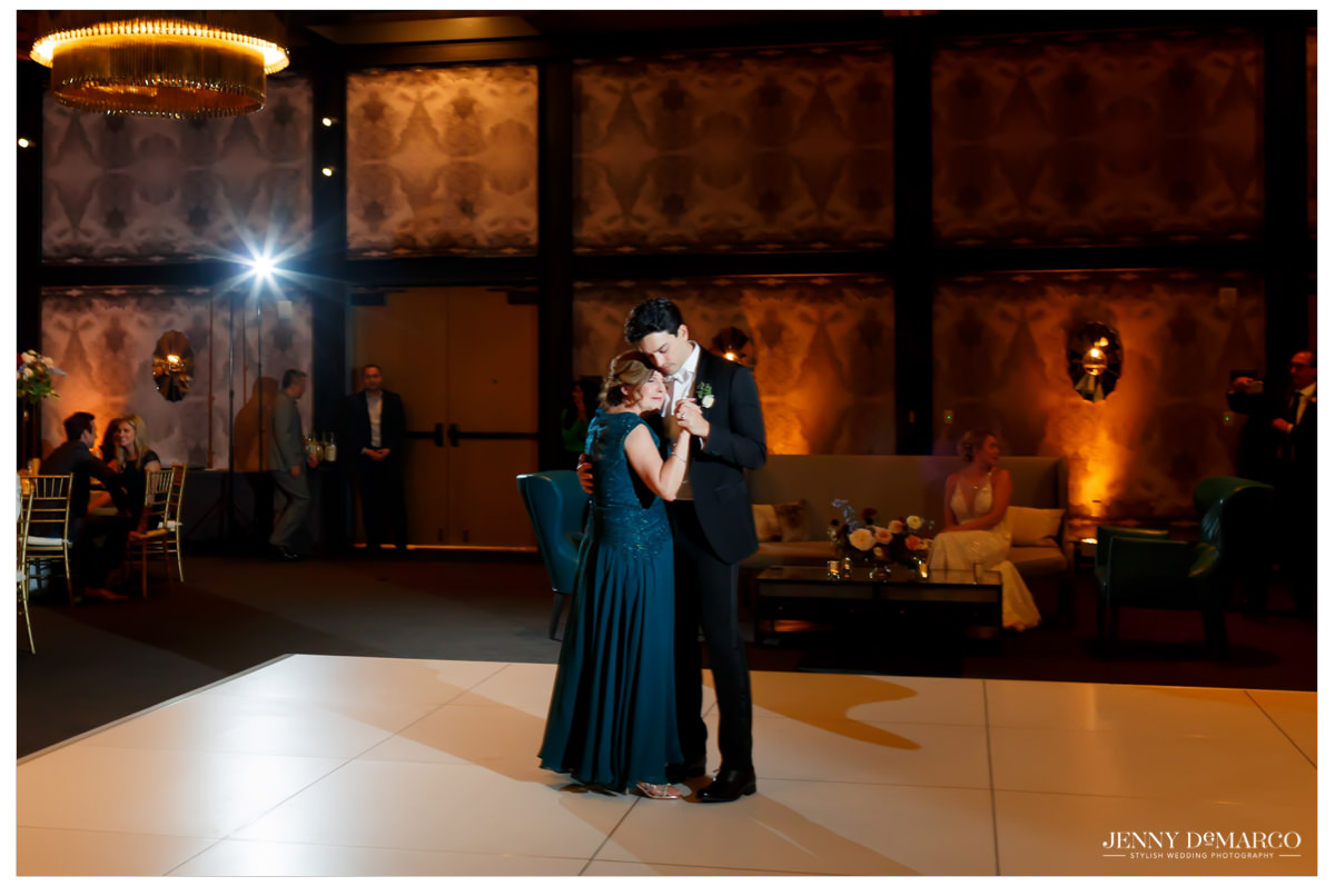 groom dancing with his mother at the reception