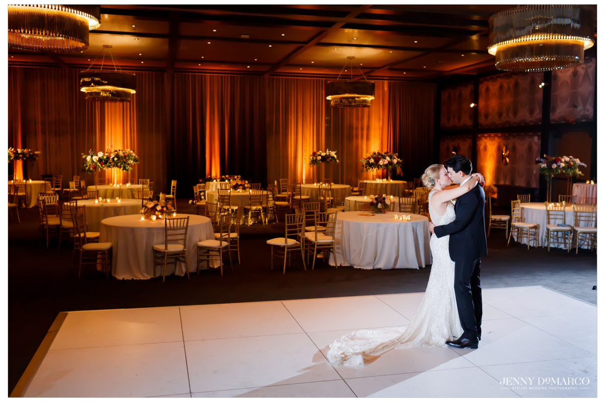 bride and groom kissing on the empty dance floor
