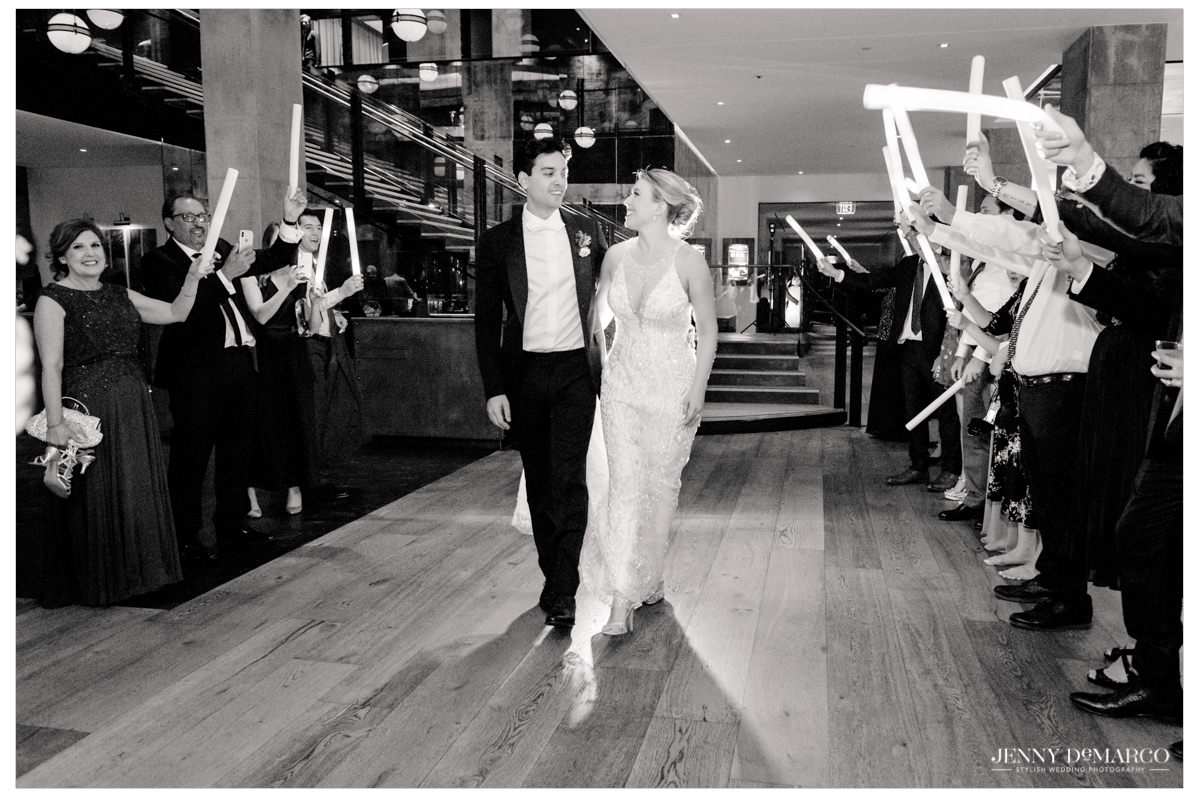 bride and groom celebrating as they exit the reception