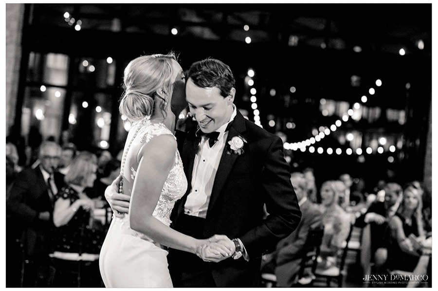 Bride and groom laugh during the romantic first dance.