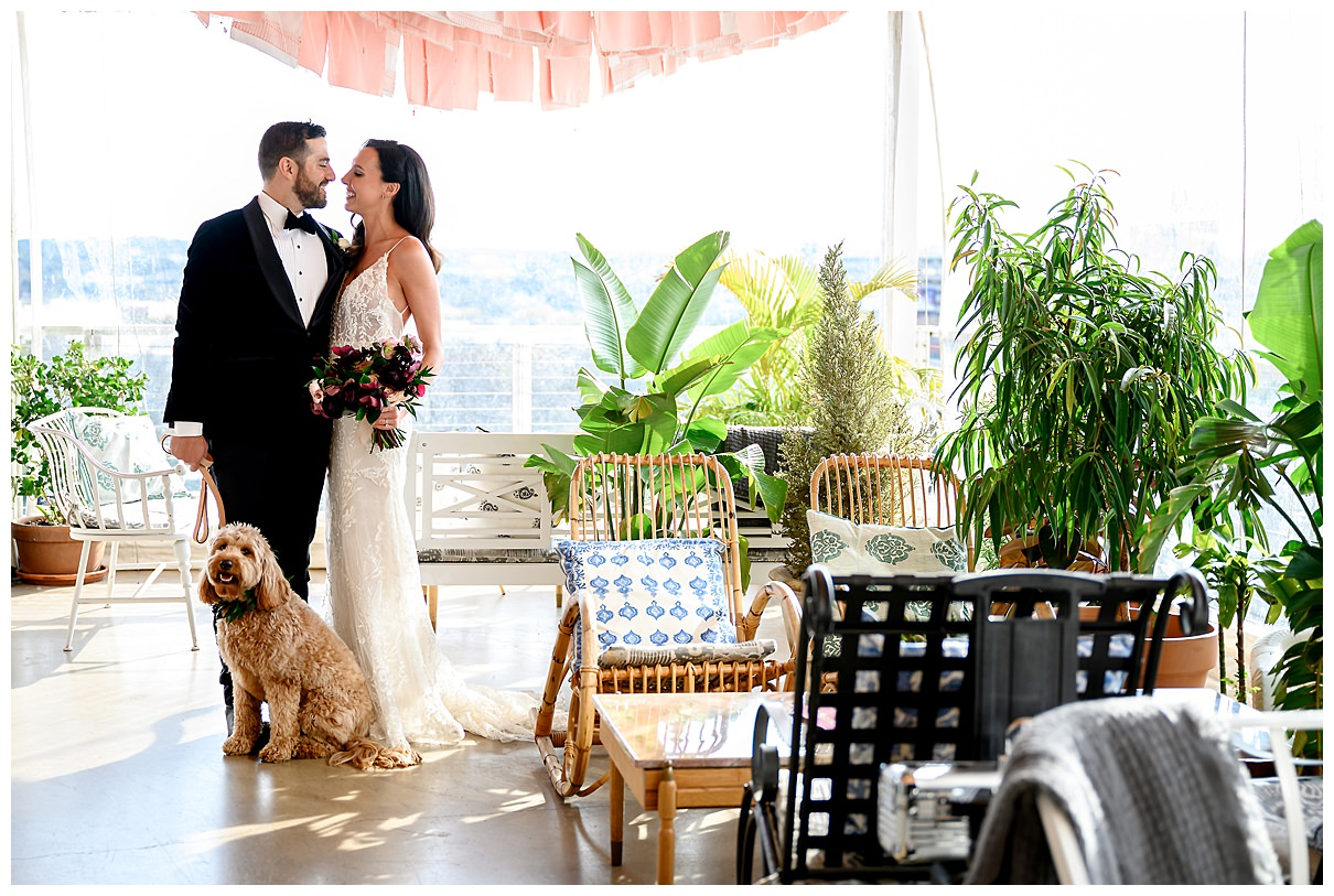 bride and groom with their golden doodle