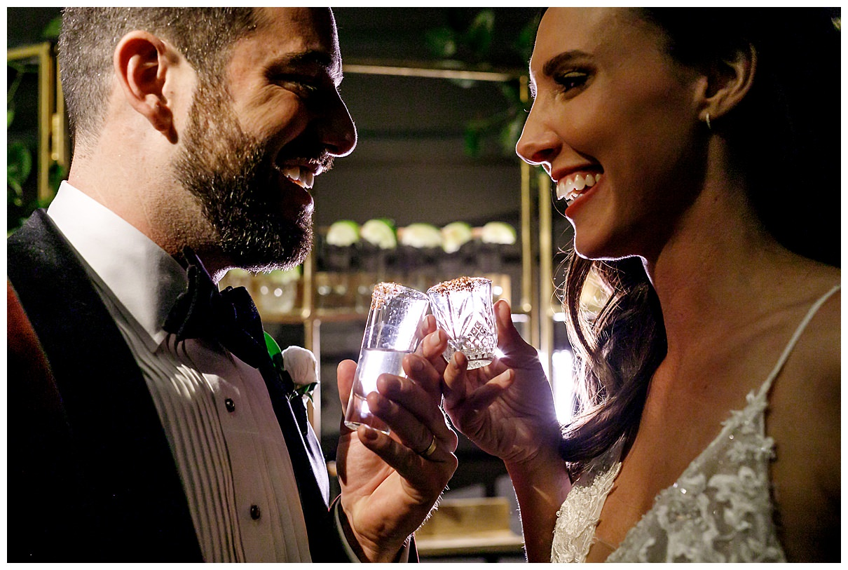 bride and groom taking shots