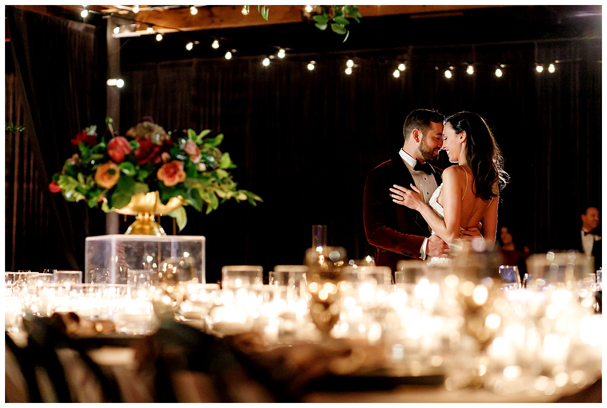 intimate candlelit moment with bride and groom