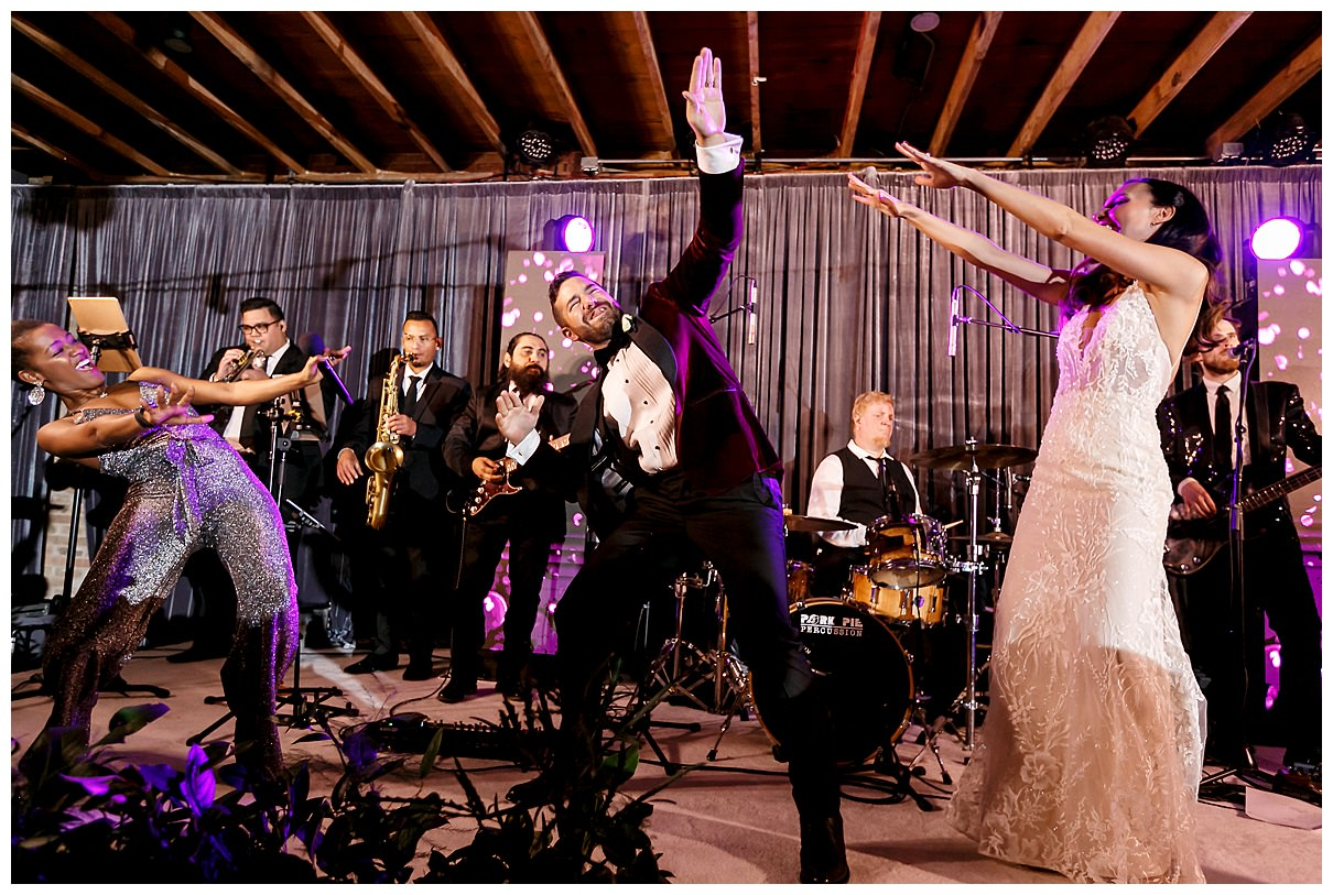 bride and groom dancing with the band