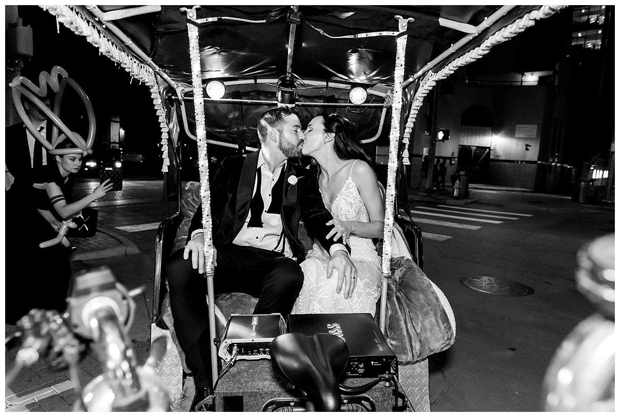 bride and groom exit kiss
