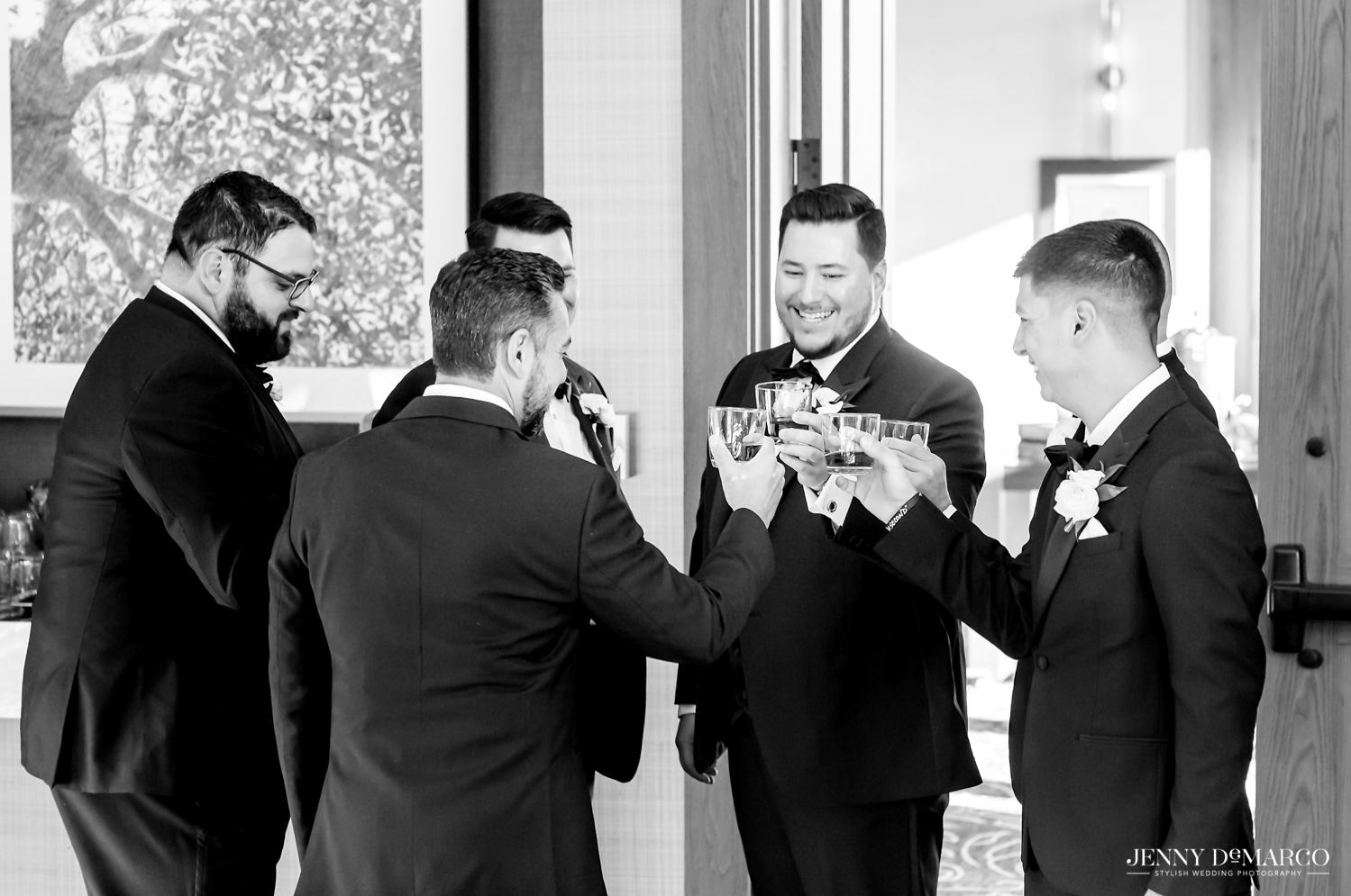groom and groomsmen toasting before the wedding