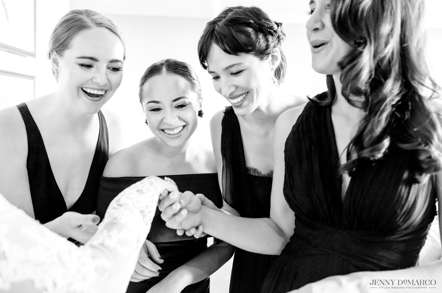 bridesmaids admiring brides engagement ring