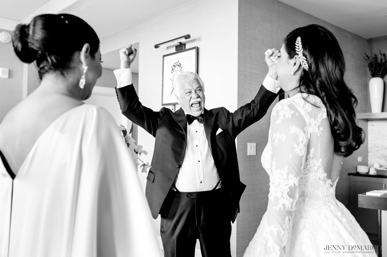 father of the bride ecstatic as he sees the bride in her dress for the first time