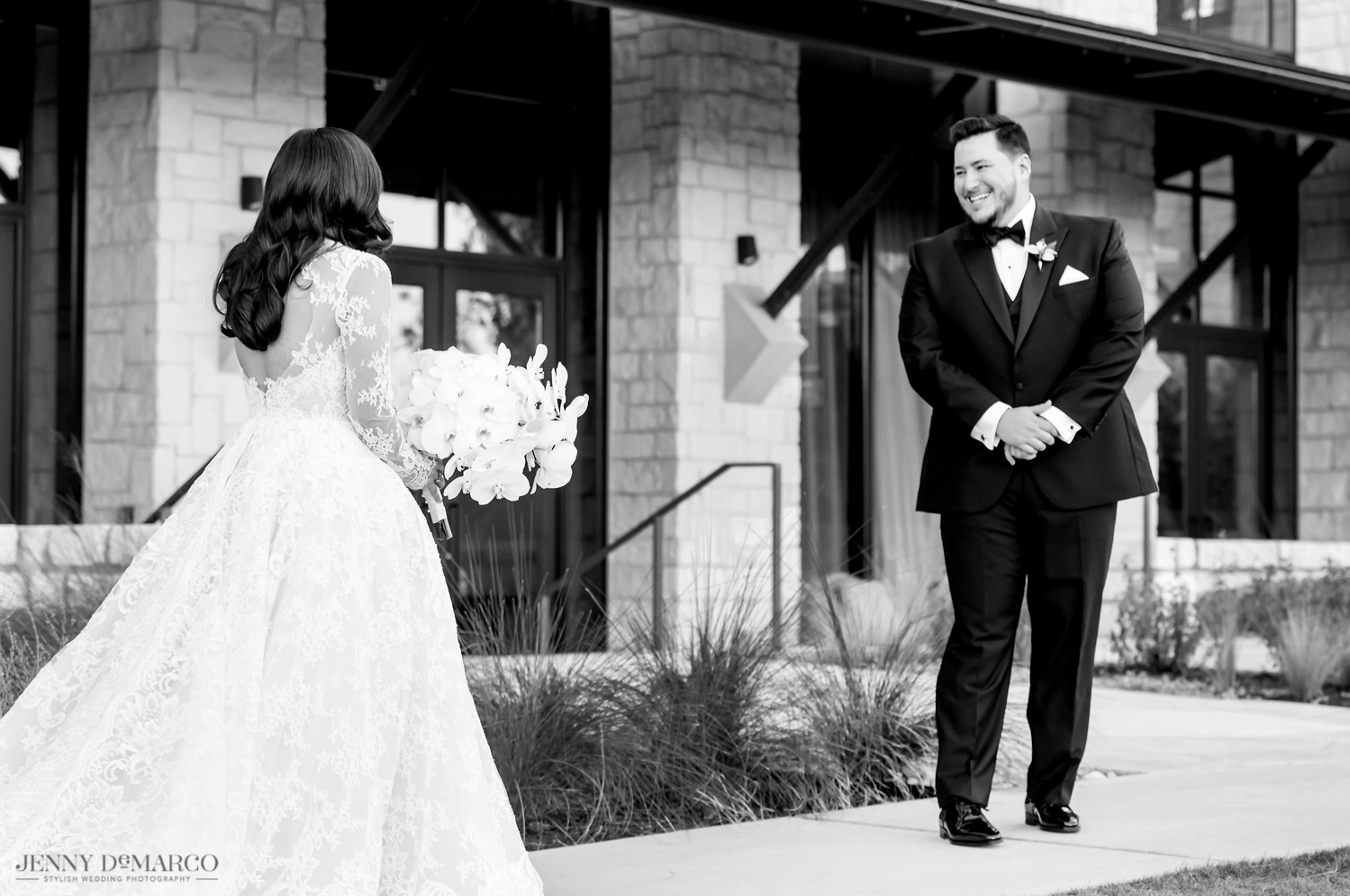 groom seeing the bride for the first time in her wedding dress
