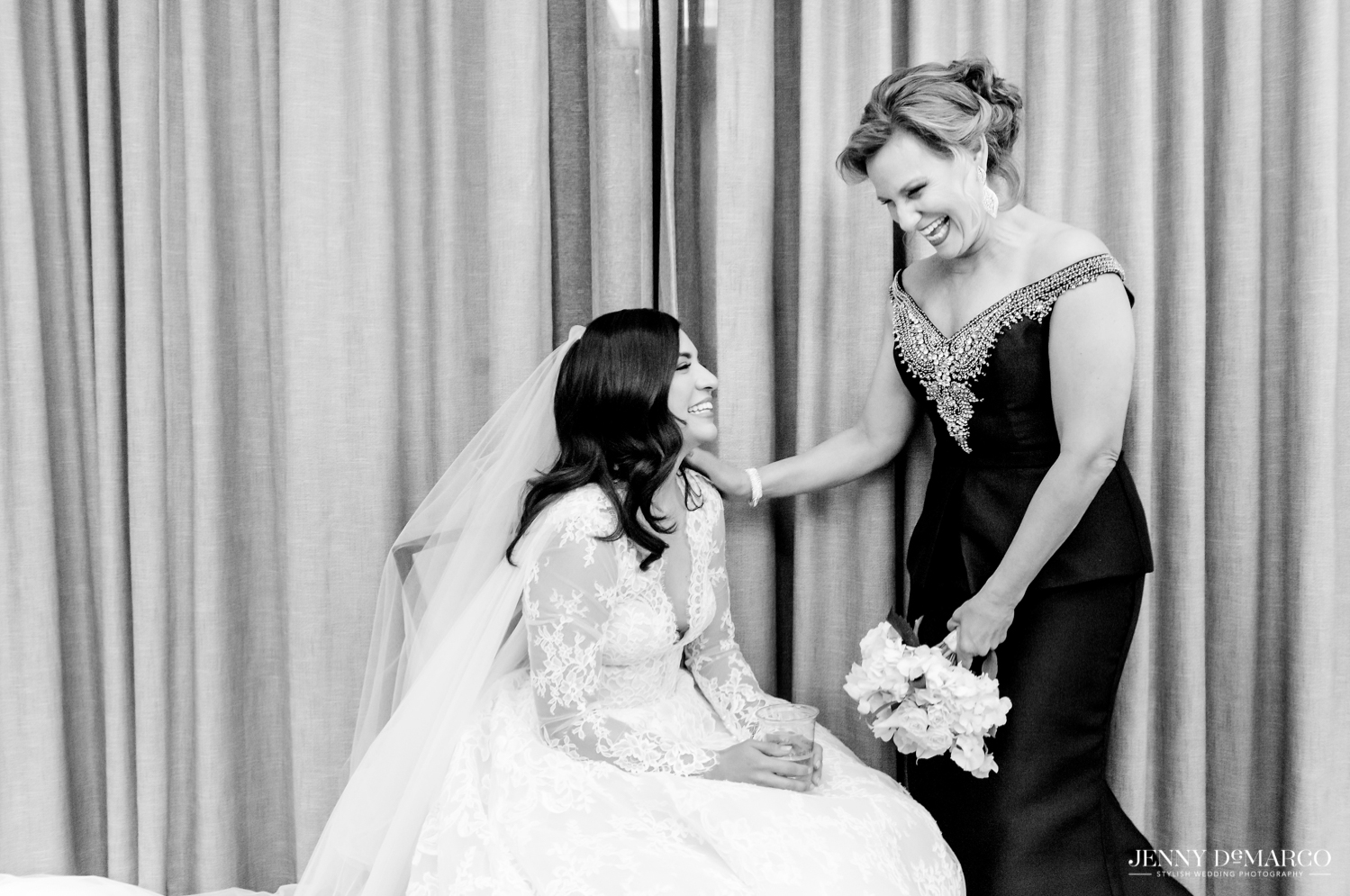 mother of the groom talking with the bride before she walks down the aisle