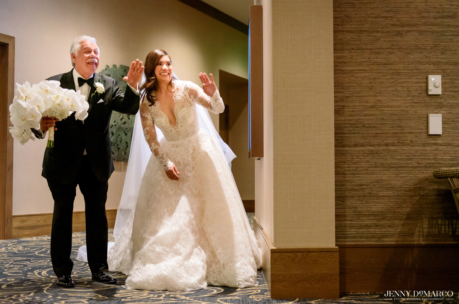 the bride and her dad waving and smiling before walking down the aisle