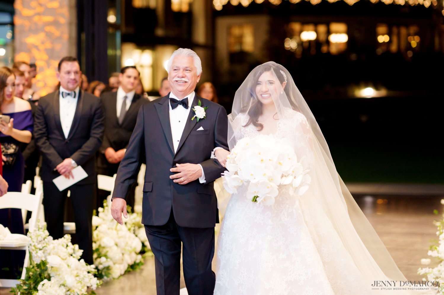 the father of the bride walking his daughter down the aisle