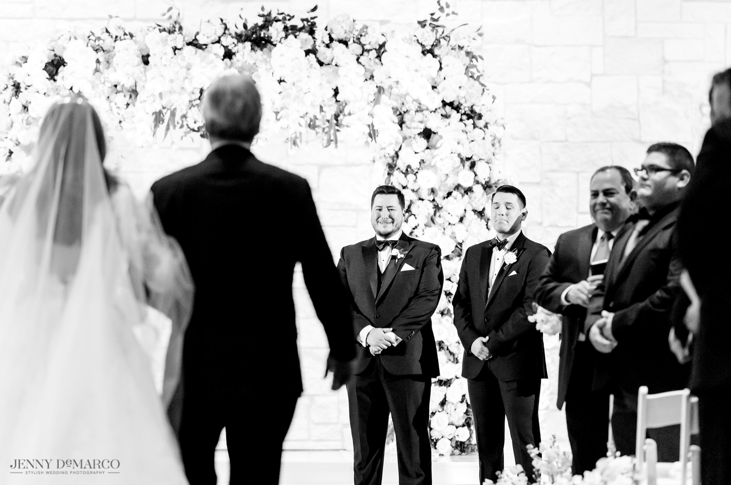 the groom crying as he sees his bride walking down the aisle