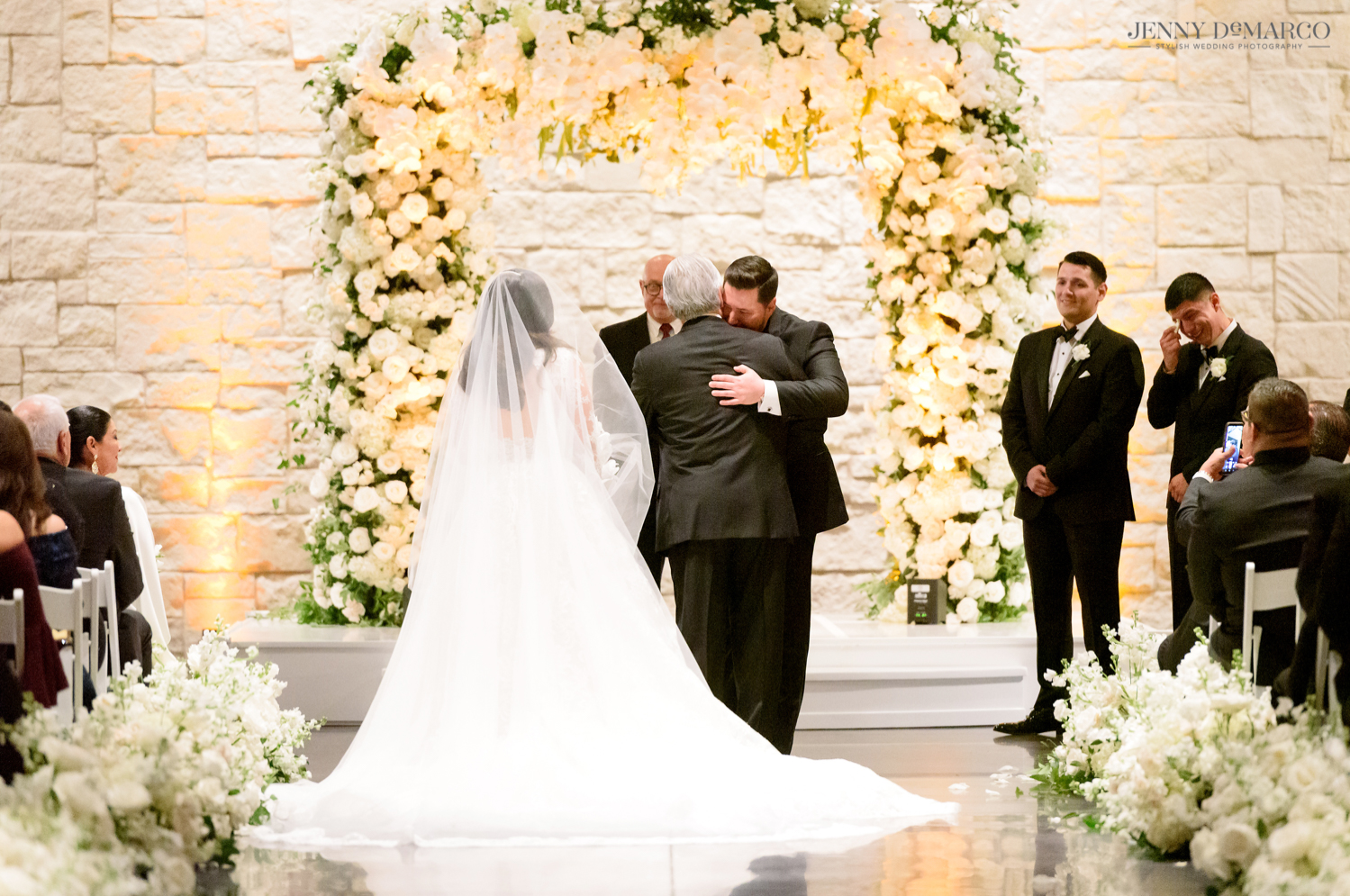 the father of the bride hugging the groom before giving his daughter away