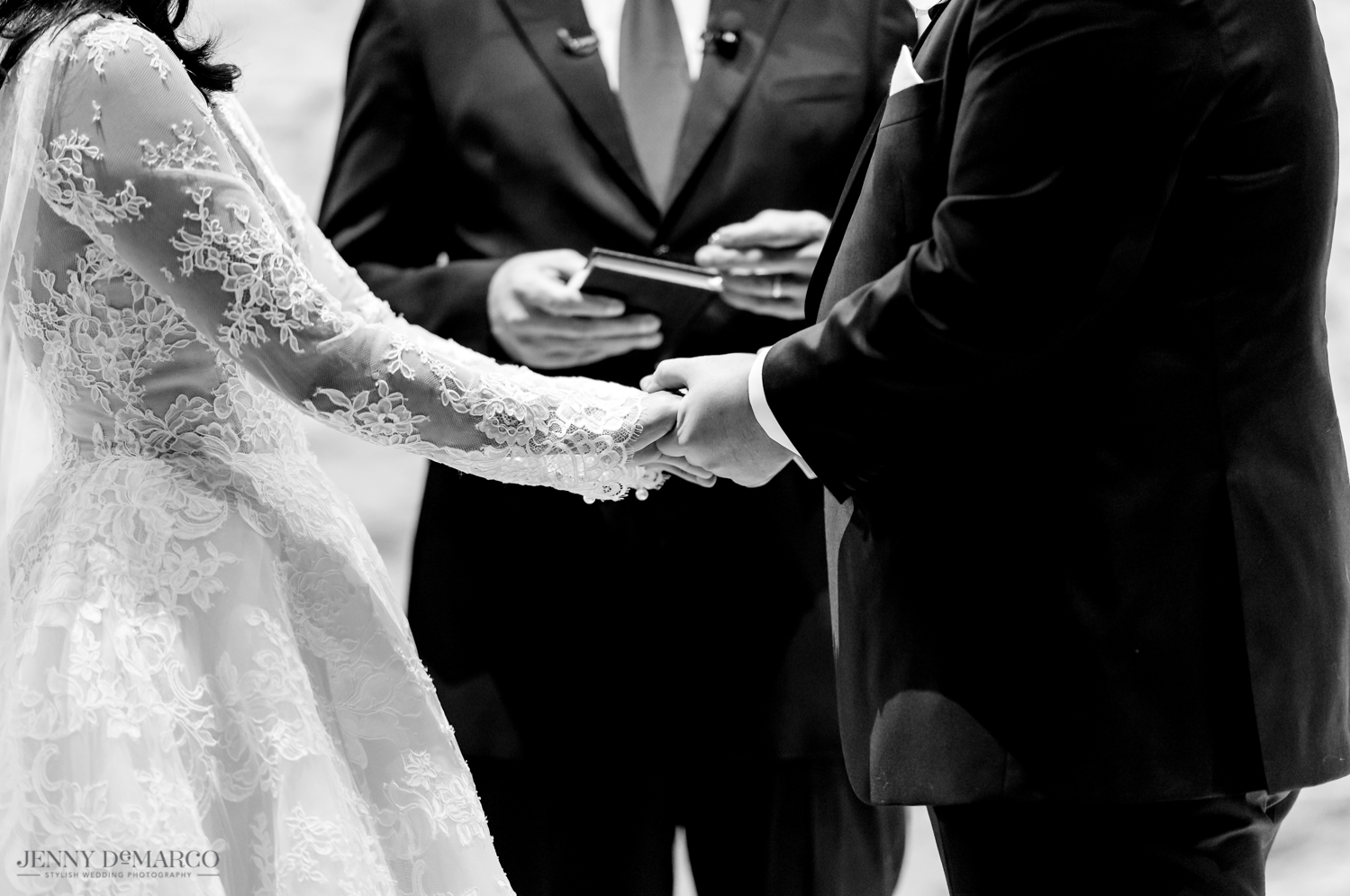 the bride and groom holding hands at the alter