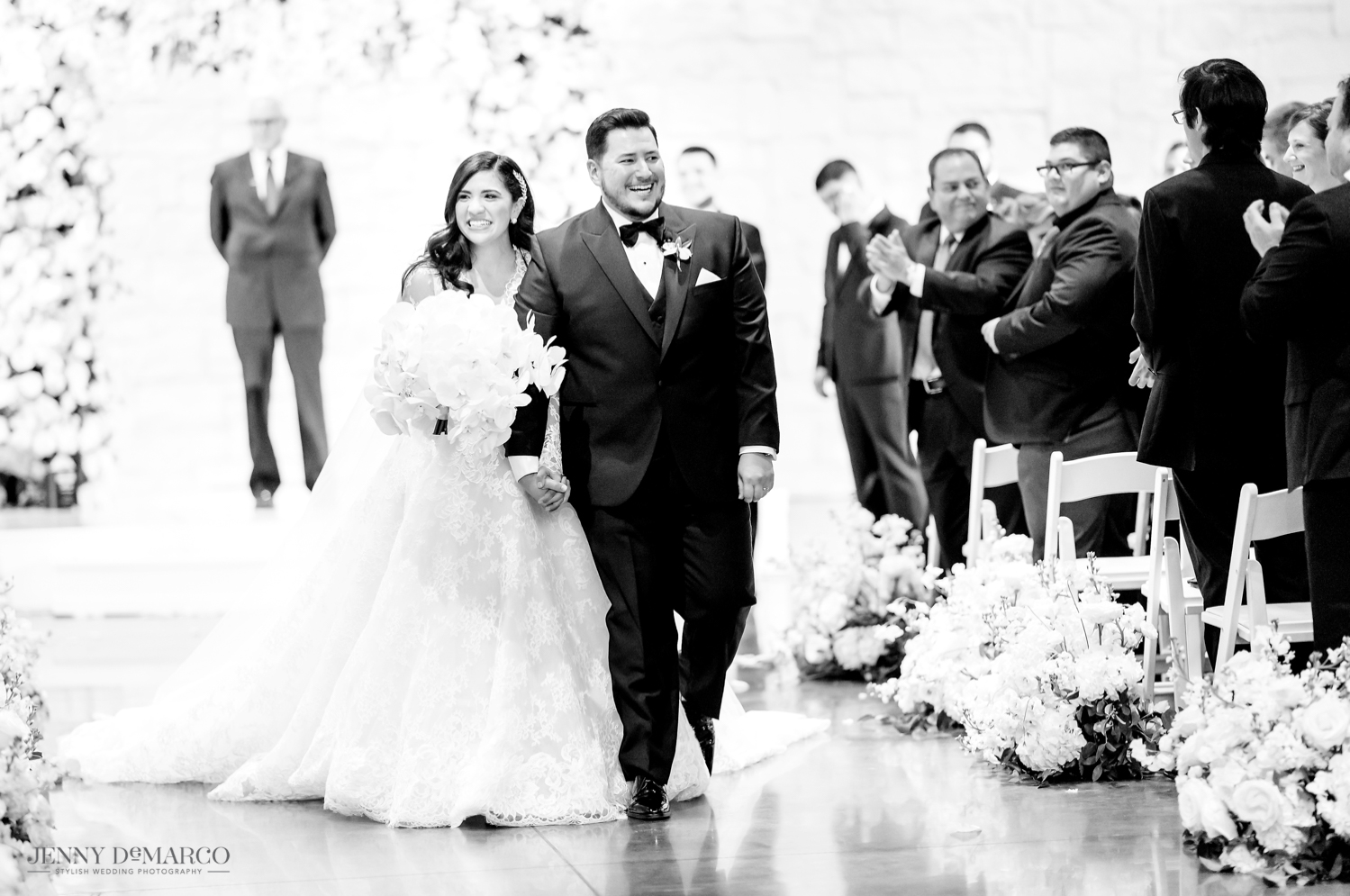 bride and groom walking down the aisle as husband and wife