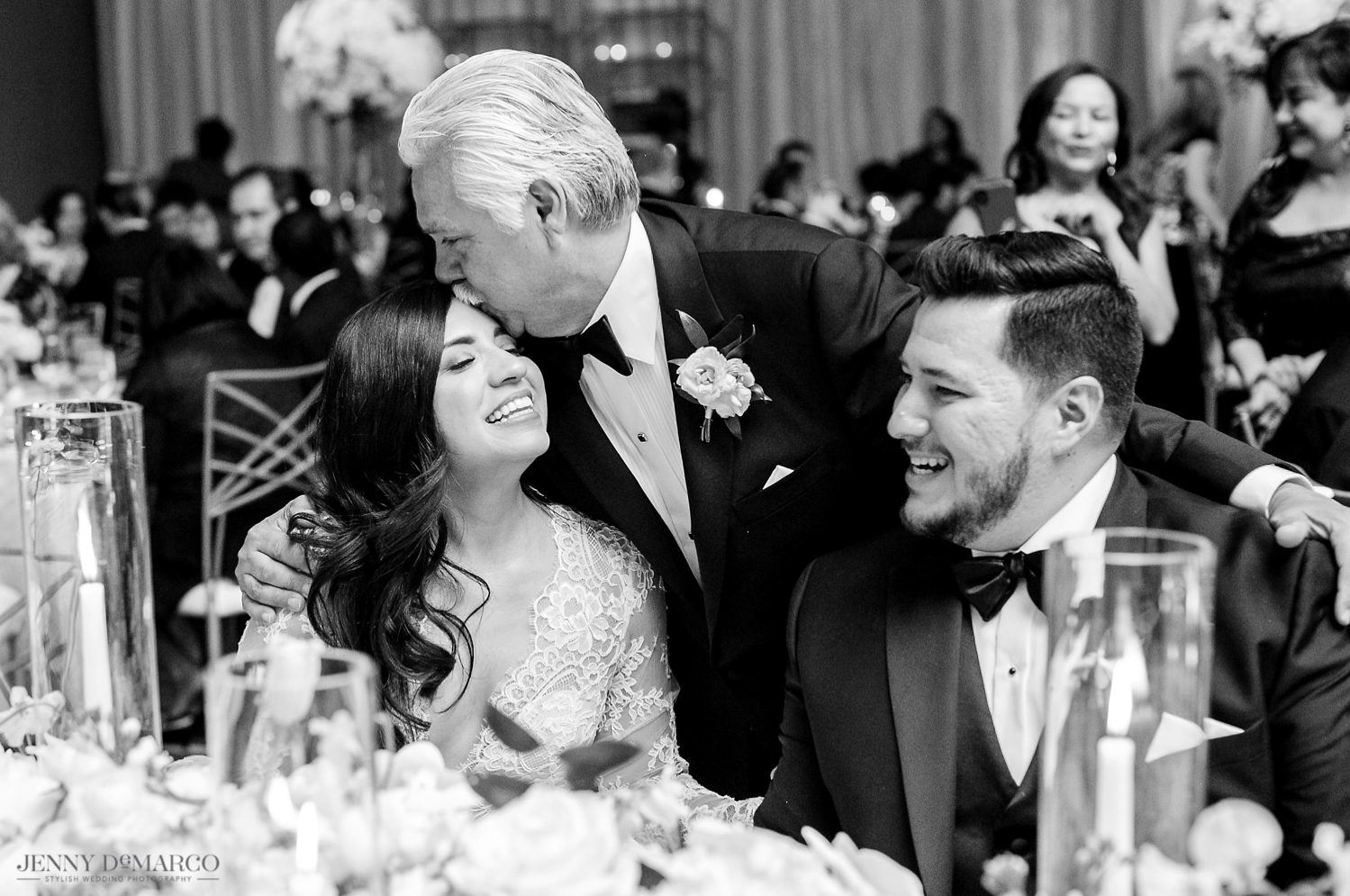 father of the bride kissing his daughter on the forehead