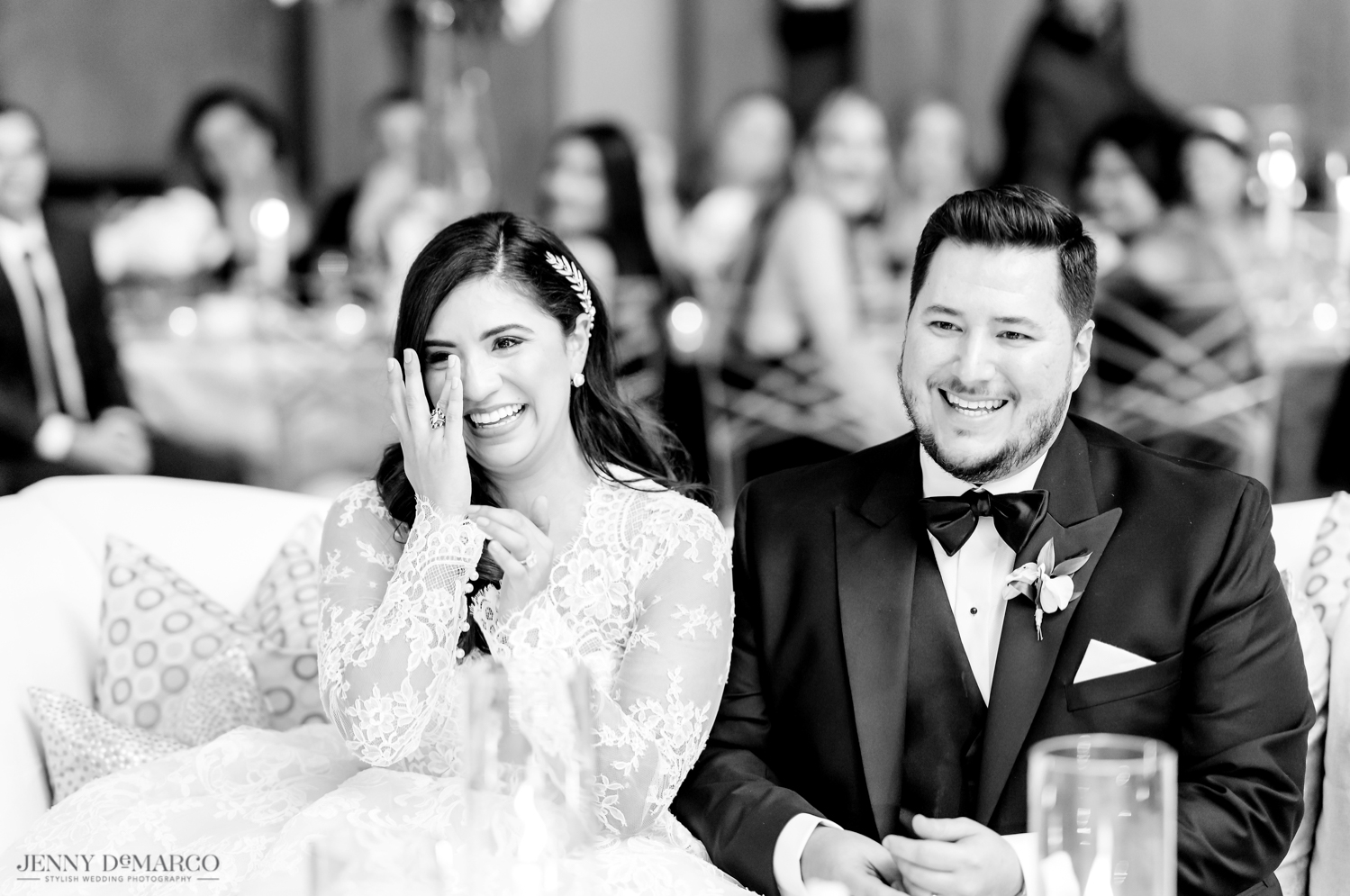 bride and groom crying as their friends and family toast to them