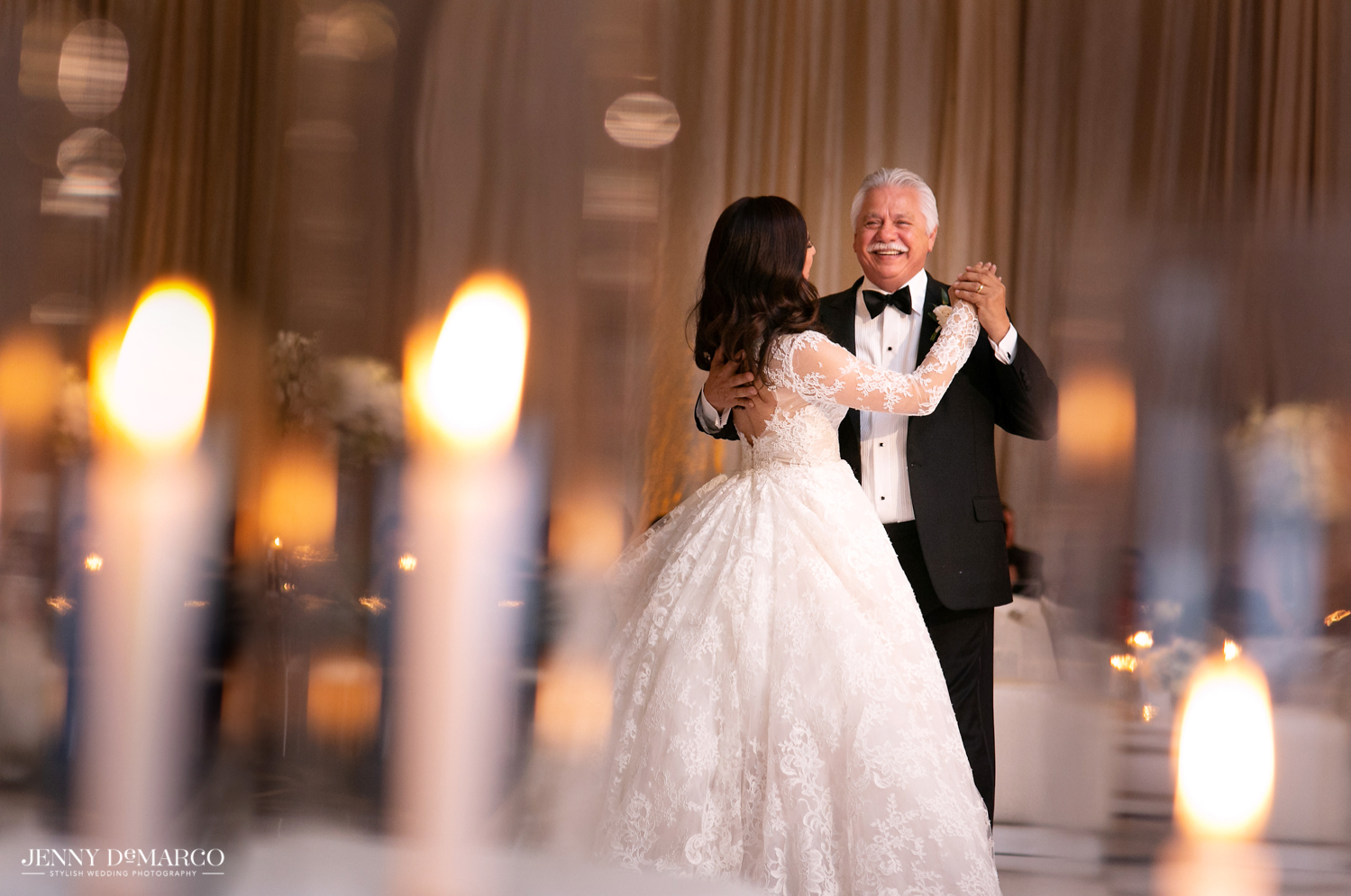 father of the bride dancing with his daughter at the wedding reception