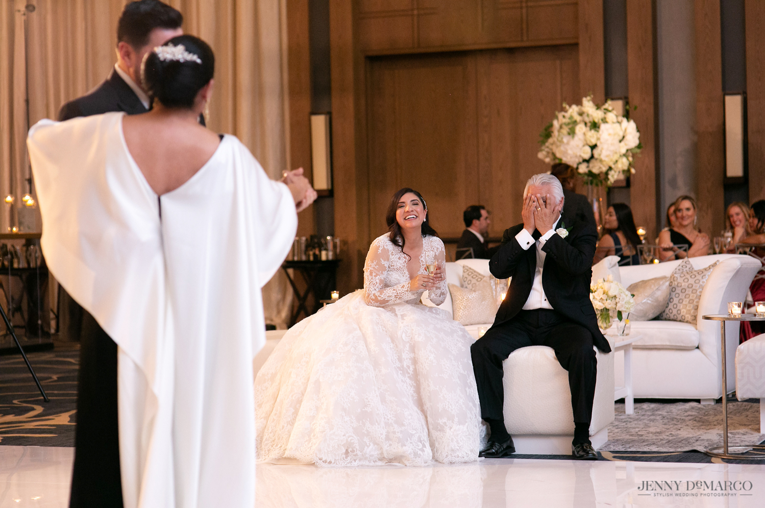 father of the bride making faces as the groom dances with his wife
