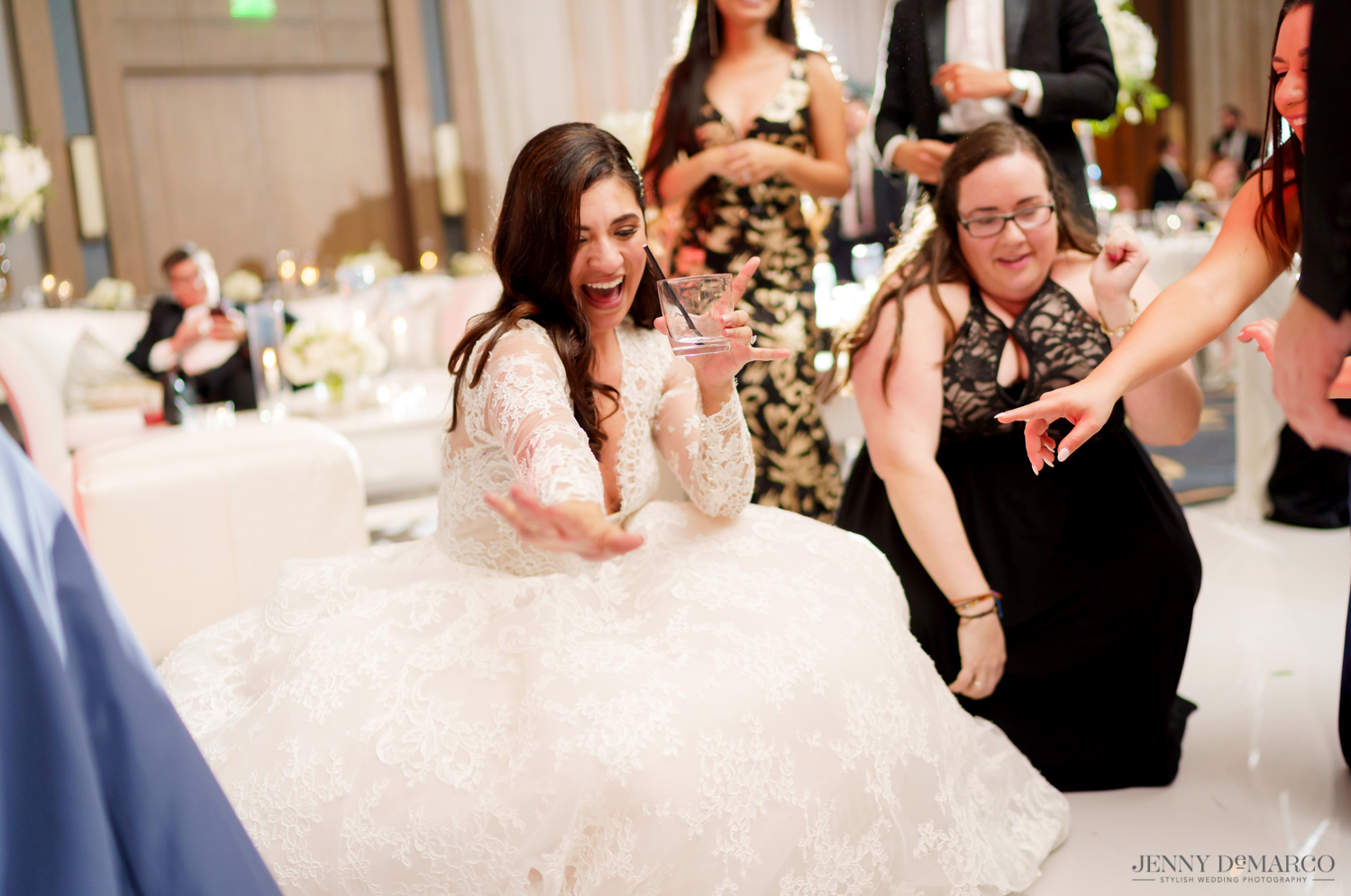 bride getting low on the dance floor with her friends