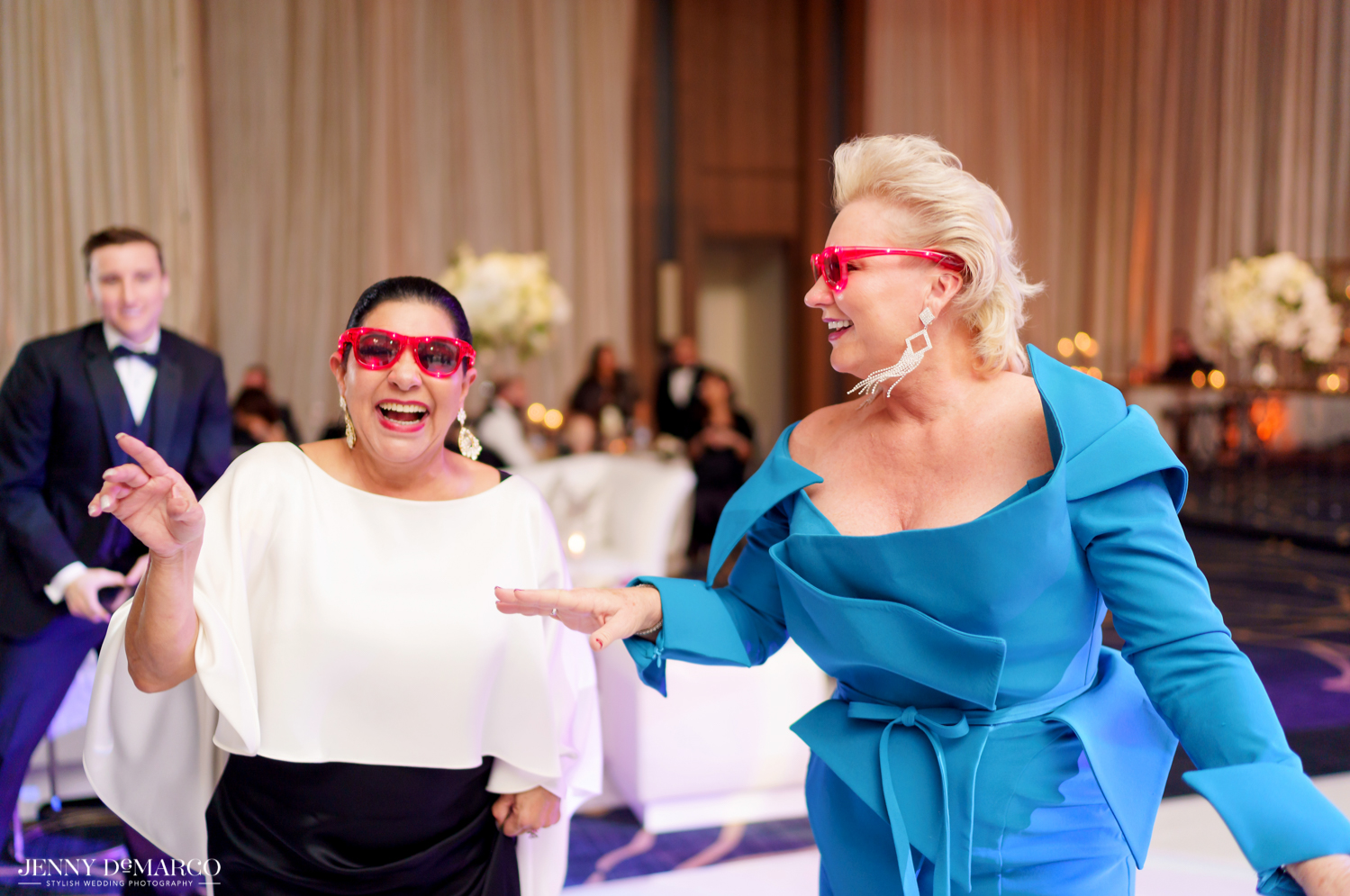 guests dancing at the wedding reception with fun sunglasses on