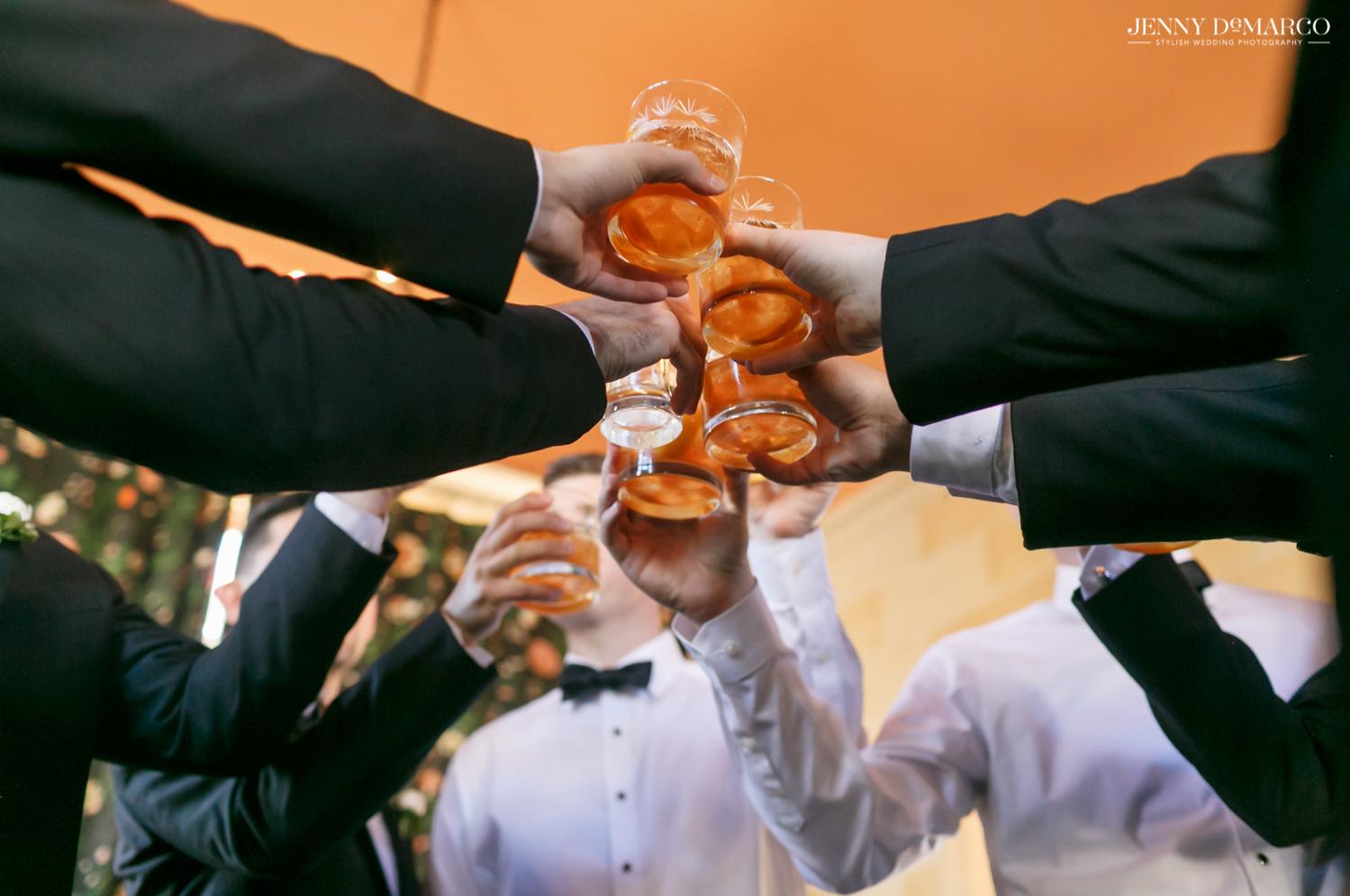 groomsmen toasting their drinks
