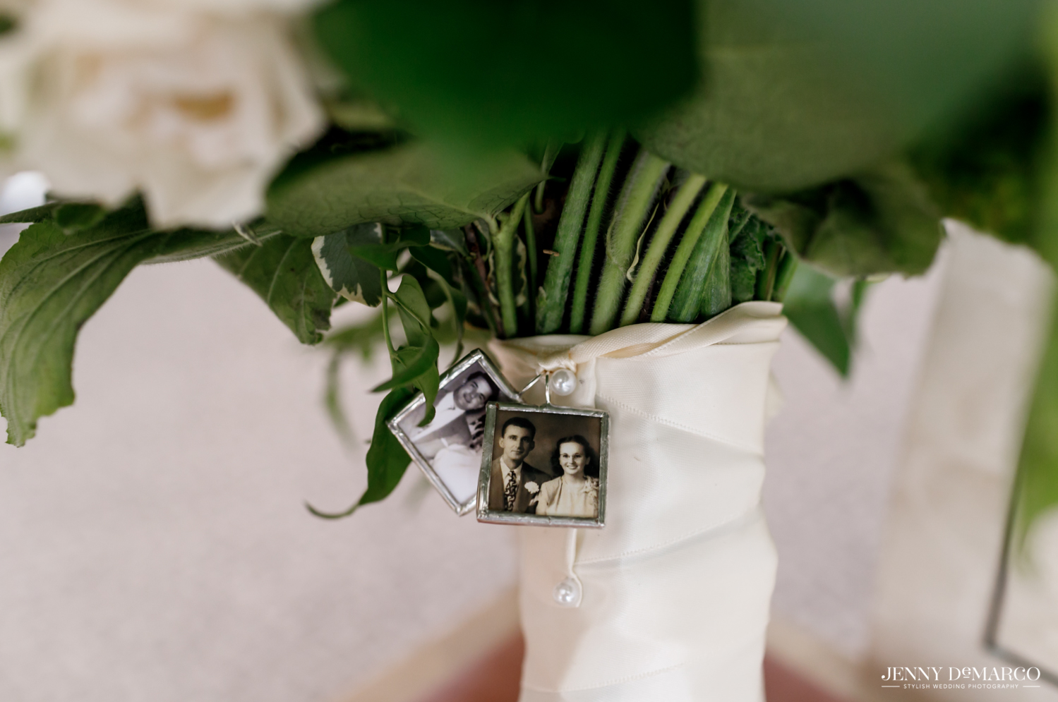photos of relatives attached to the bridal bouquet