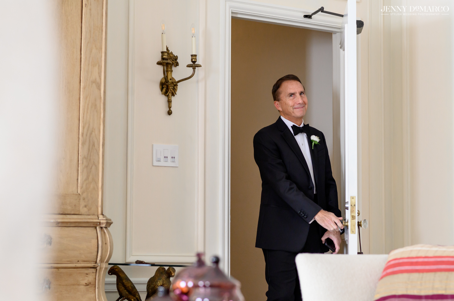 father of the bride seeing his daughter in her wedding dress for the first time