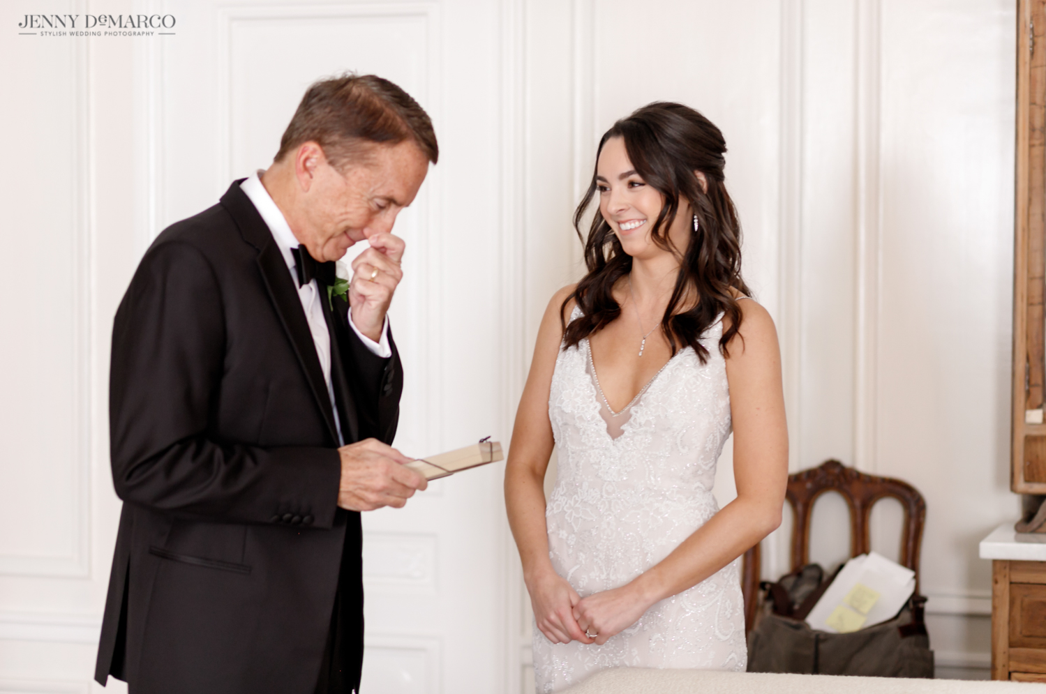 father of the groom crying while reading a note from his daughter