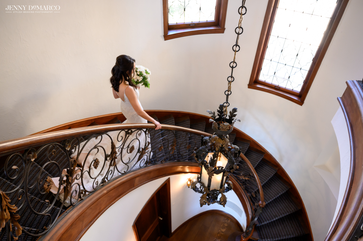 bride walking down the staircase in the commodore perry hotel