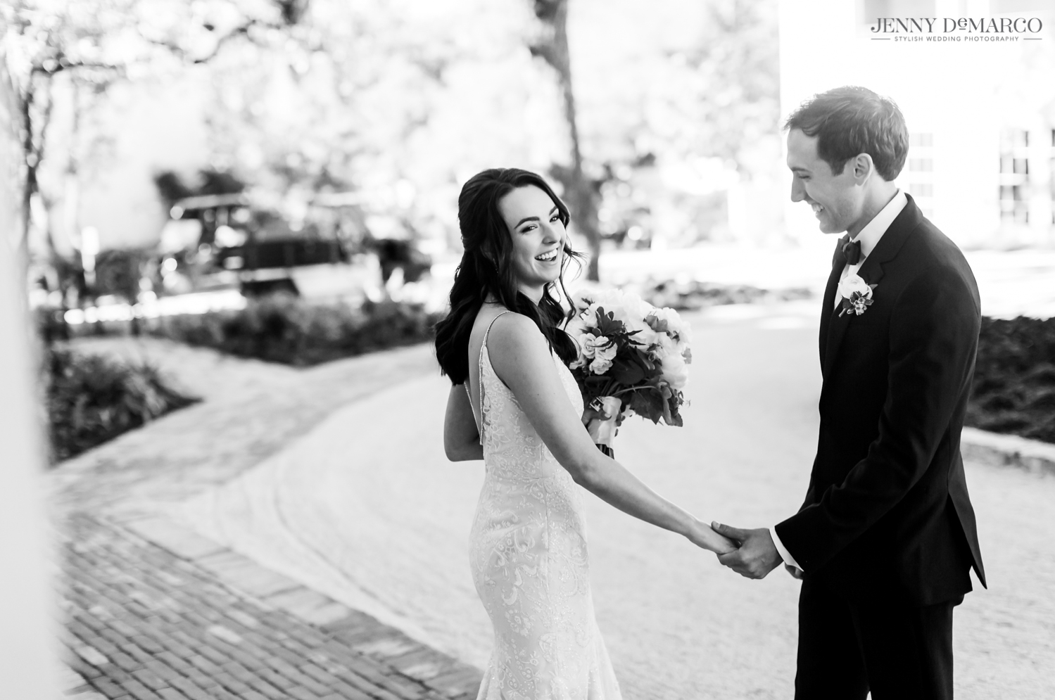 bride and groom holding hands and laughing during the first look